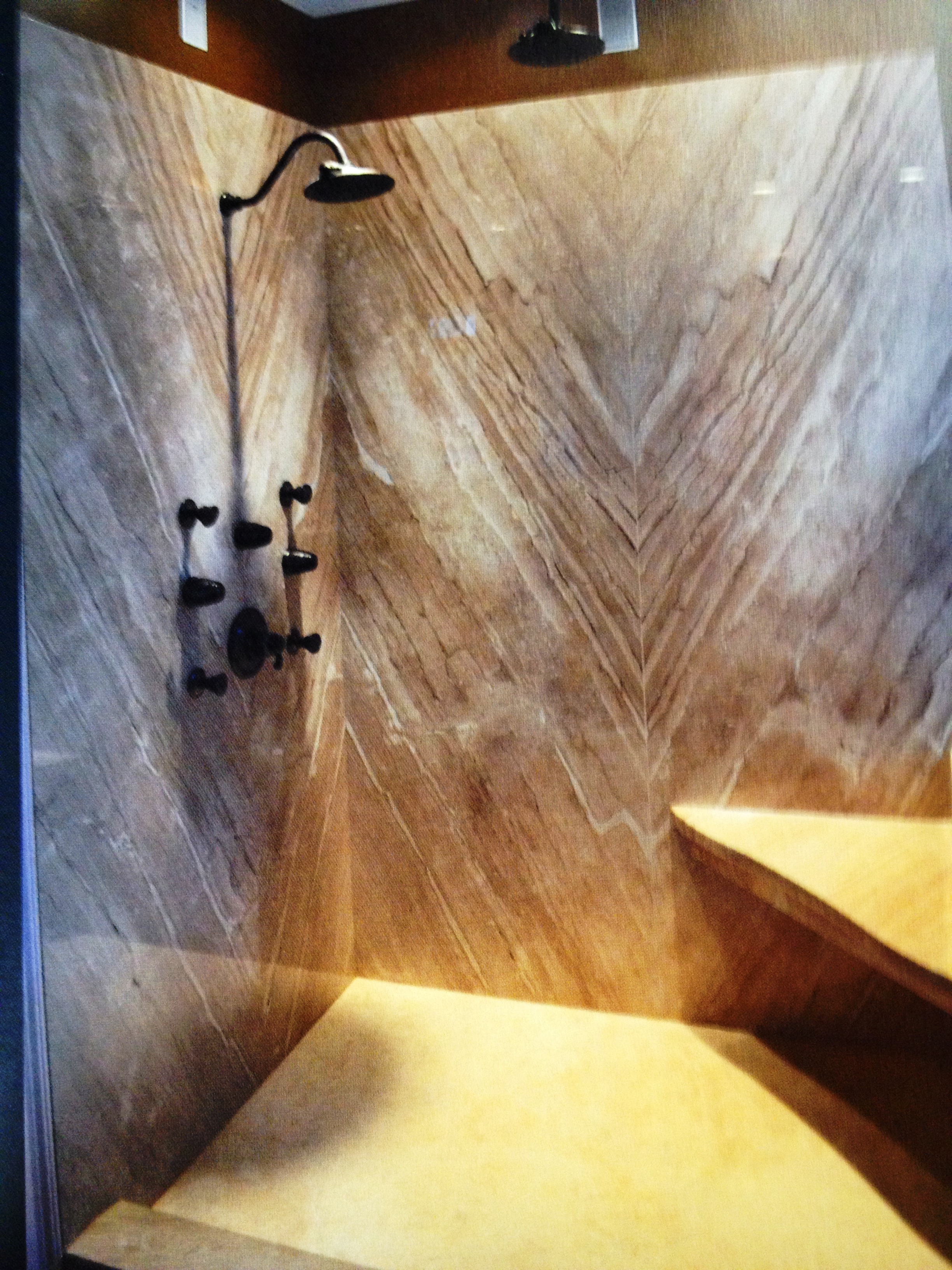 Four slabs of bookmatch Diano Reale marble and not a teaspoon of grout make up the master bath shower makeover. Cut to perfection!