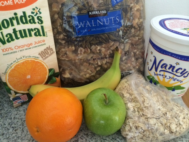 Soak the oats in OJ, add yogurt, chop and add any kind of fruit. Toast the walnuts in the micro for 1', then sprinkle on top.