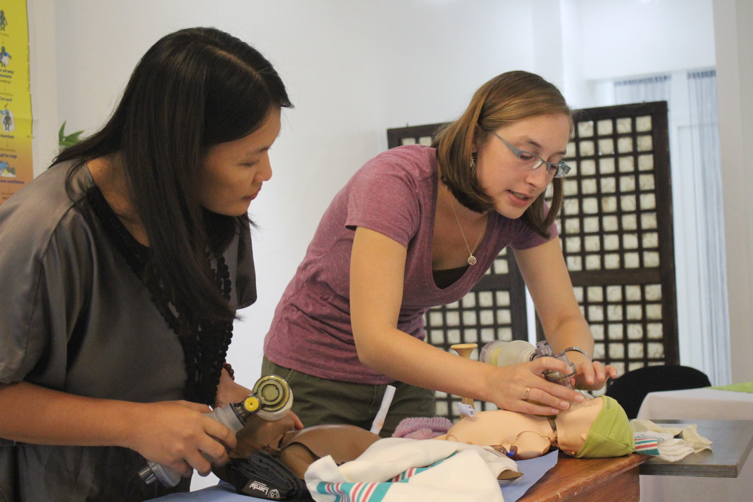 The best part of this diploma program is the contribution the Diploma Scholars make to global maternal child health, both now and into the future, by elevating the skills of midwives in vulnerable countries where the current rate of neonatal and maternal deaths is unacceptably high. Shown here, Diploma Scholar Kluane demonstrates proper technique for neonatal resuscitation during capacity building training for midwives in a recovering disaster zone. After she leaves, they will continue the trainings.