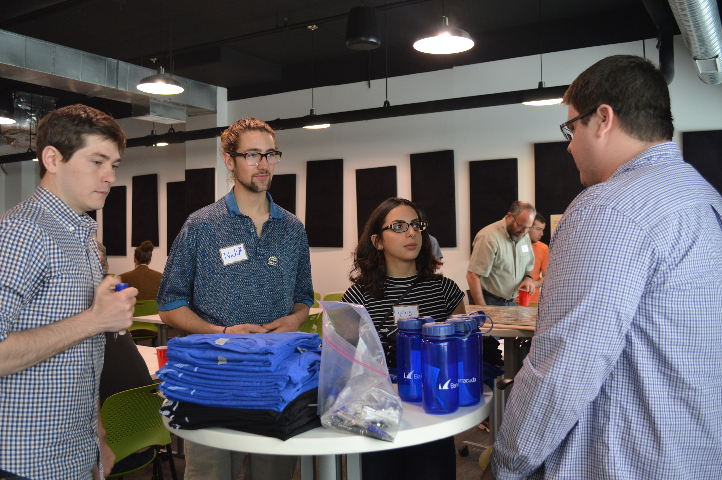 Apollo alumnus Alex John talks about his company and passes out promotional materials.