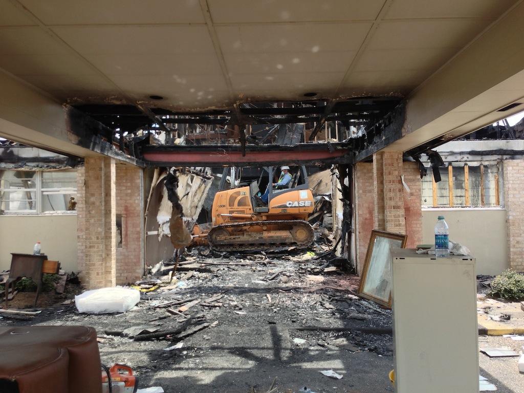 Demolition of the burned structure began on Monday, September 16, 2013. (Jeremy Hagood/ JFN)