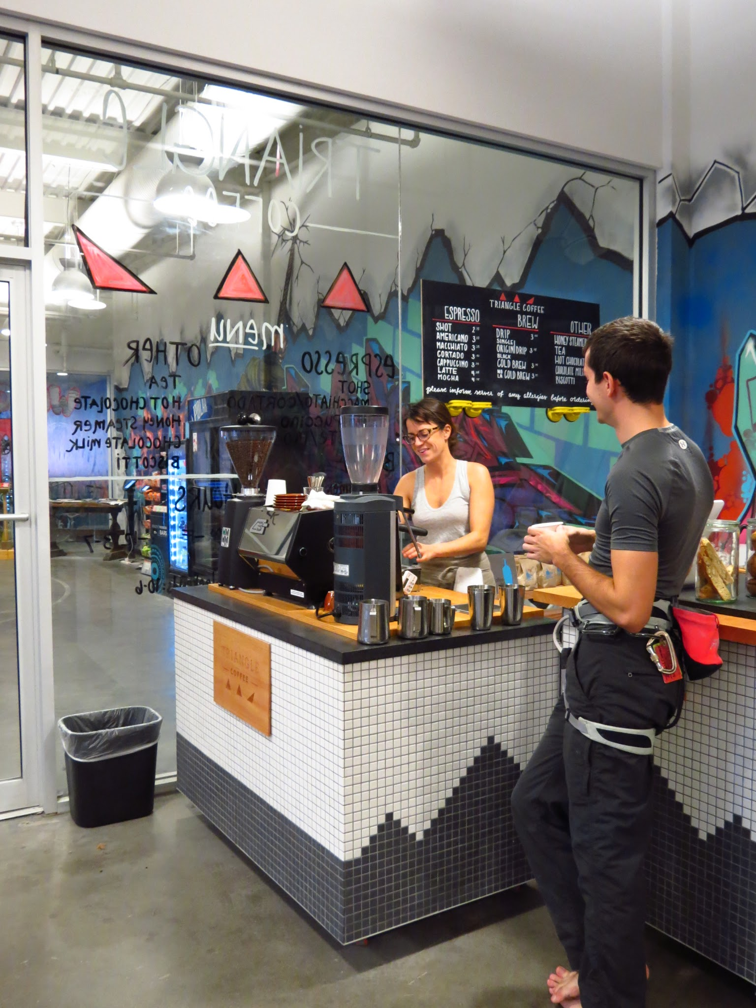 Annie Groff, co-founder, chats with a customer taking a break from climbing at Brooklyn Boulders in Somerville.