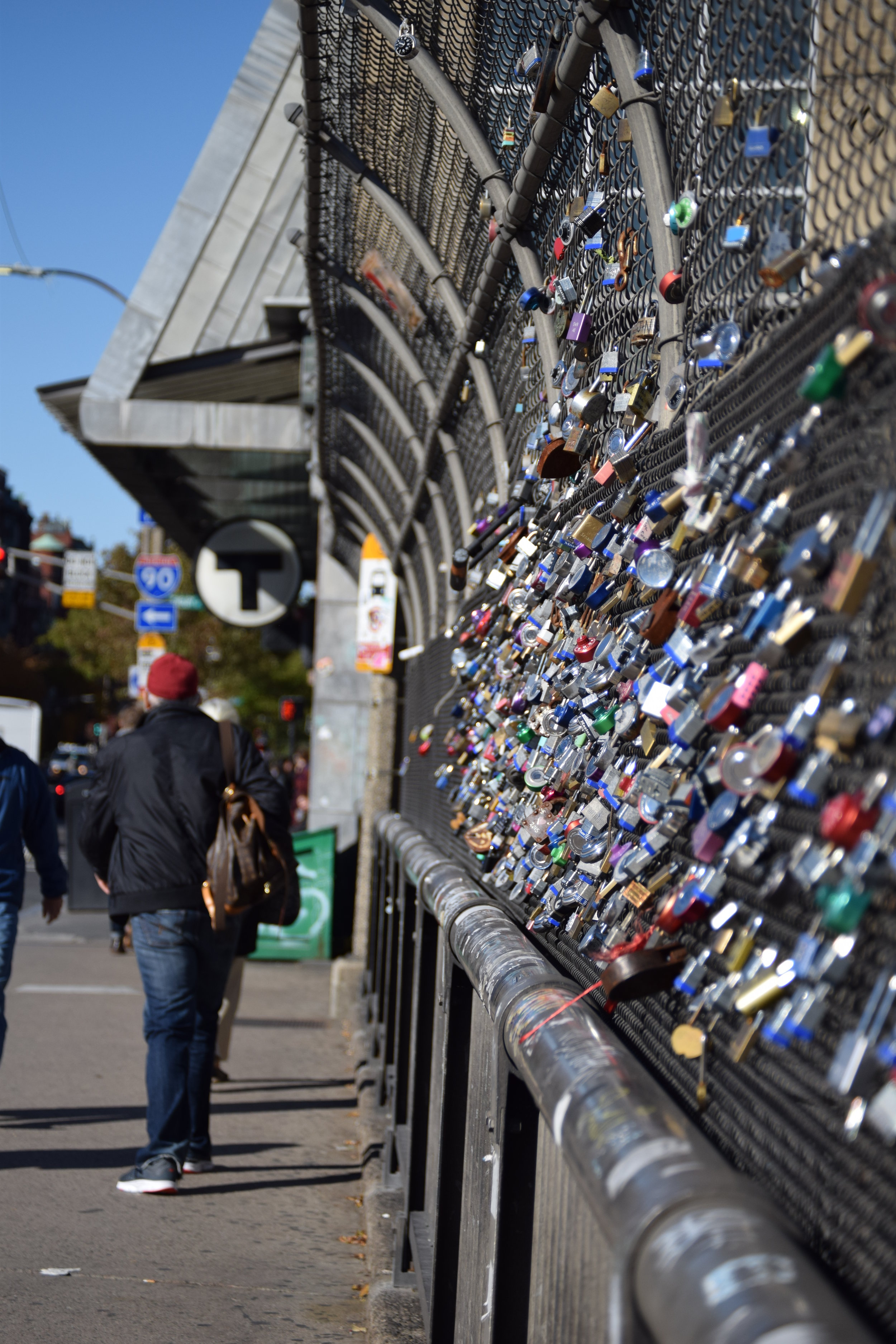 Padlocks with sentimental messages,known as love locks, are attached to the bridge over I-90 on Massachusetts Avenue in Boston, MA.