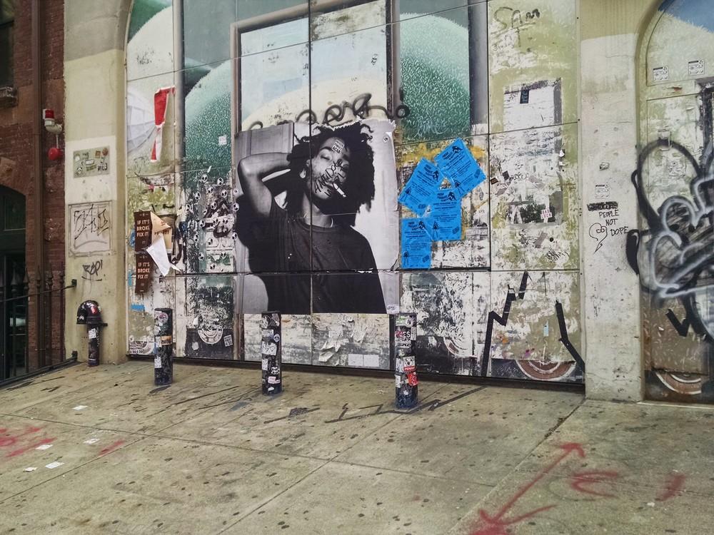 Graffiti lines the walls near the corner of Newbury Street and Massachusetts Avenue in Boston, MA.