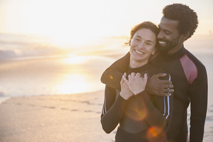 Multi-ethnic Couple in Wet Suits