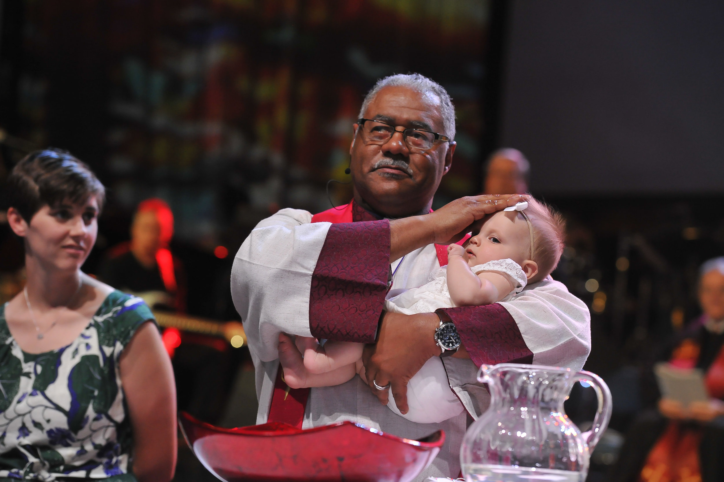 Bishop Julius C. Trimble baptizes a baby at The Commissioning and Ordination Service at the 2017 INUMC Annual Conference in Indianapolis.
