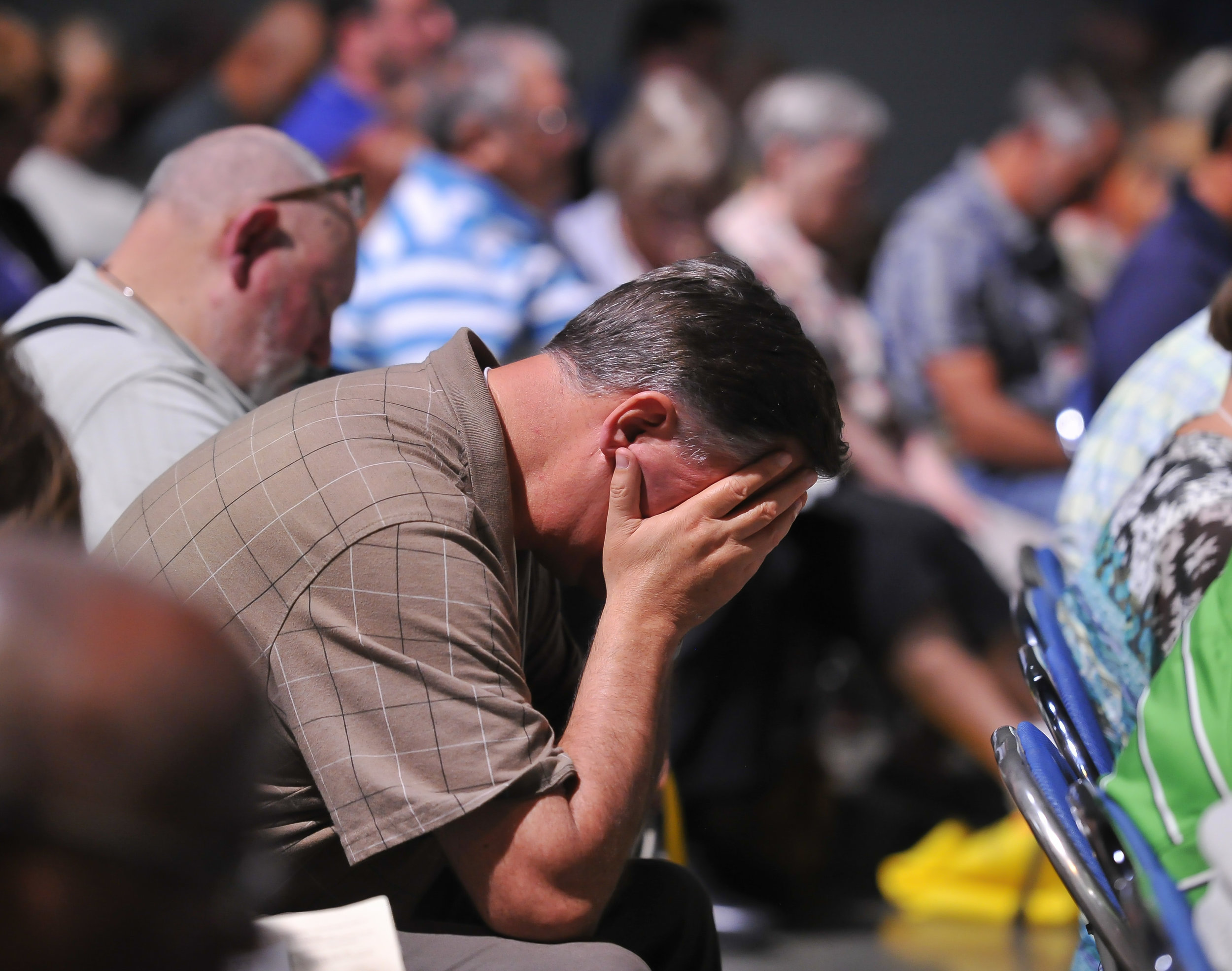 Attendees pray at the Friday Plenary at the 2017 INUMC Annual Conference in Indianapolis.