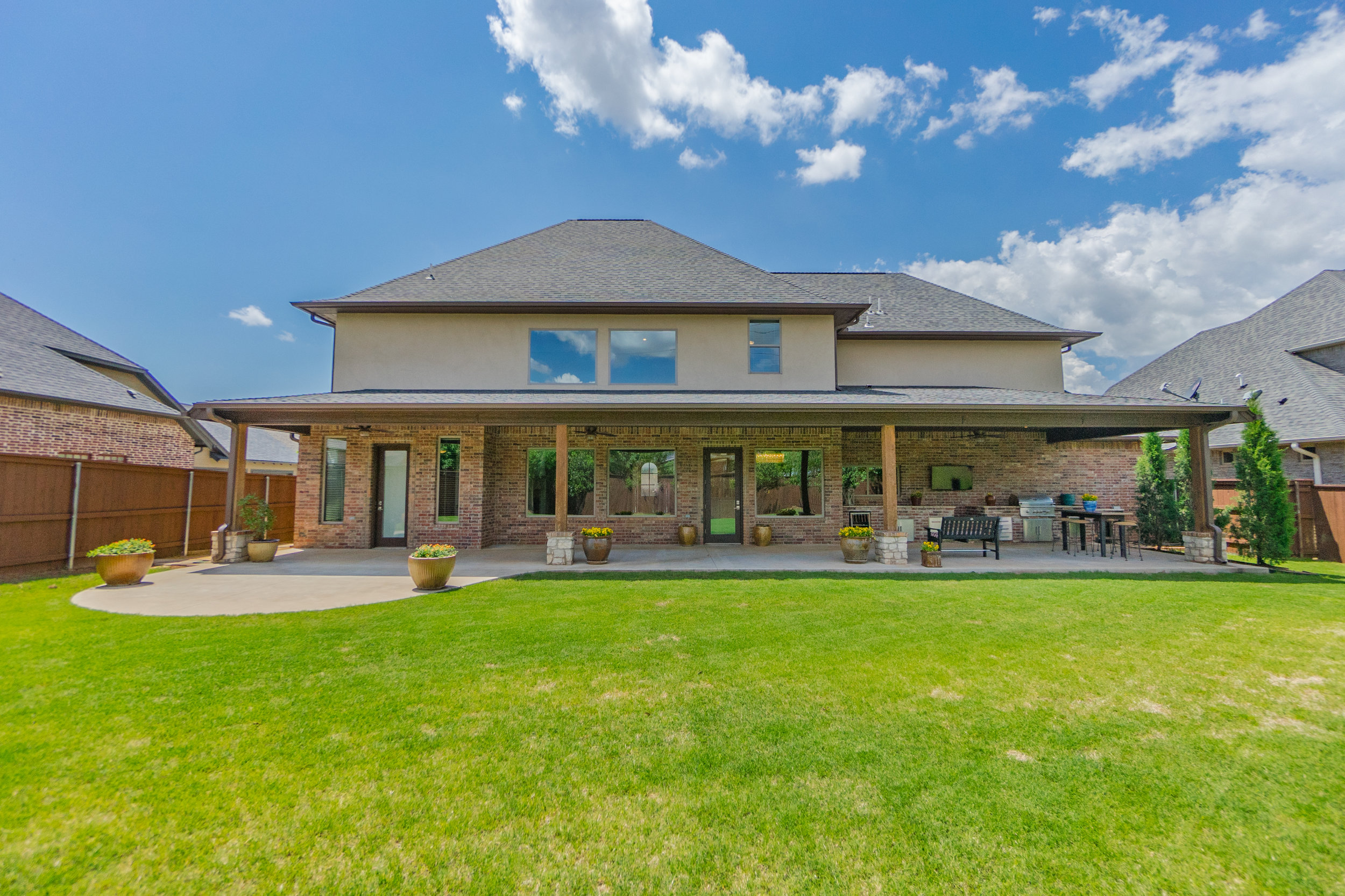 generous backyard and covered patio - all designed for fun and entertaining