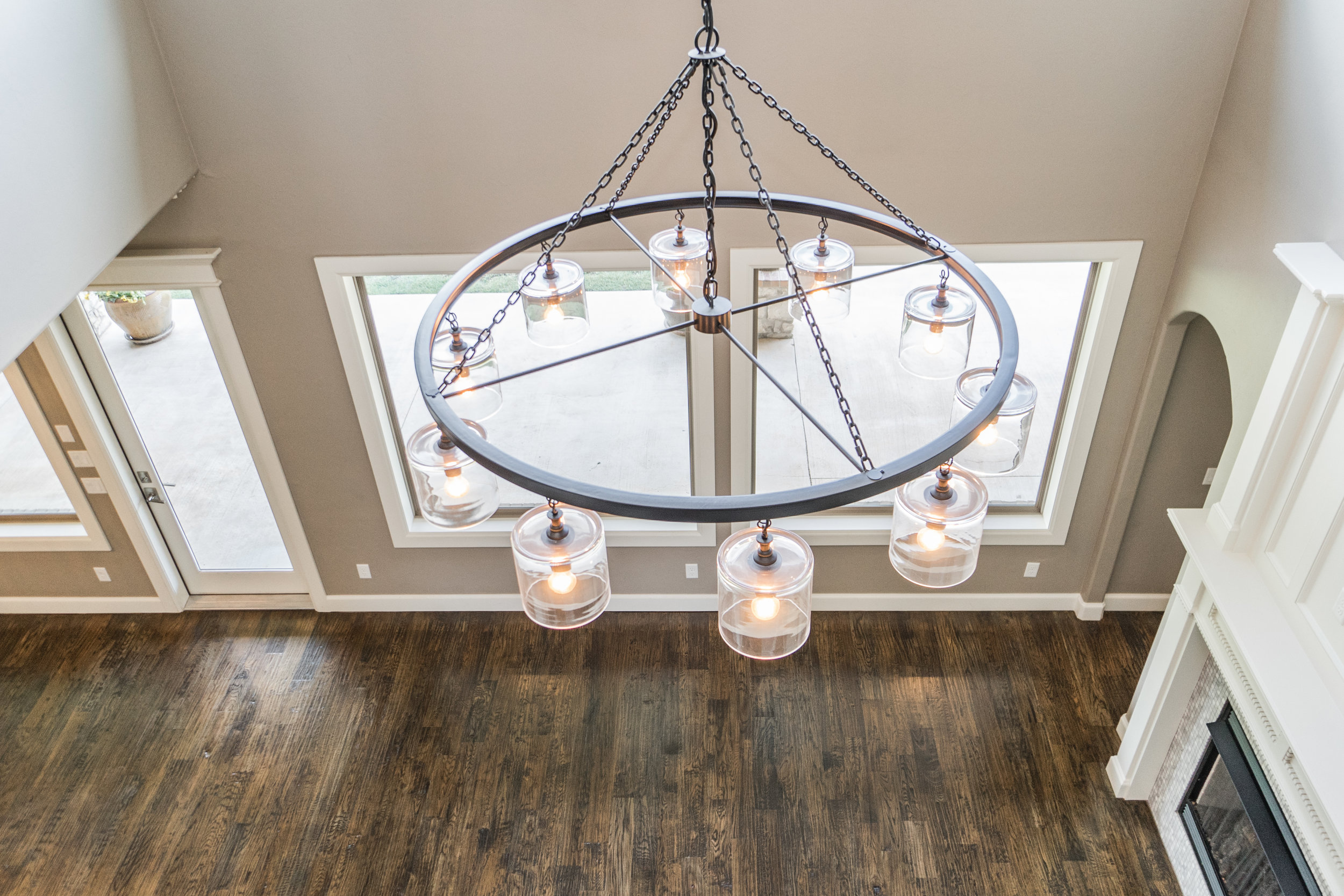 overview of living, Restoration Hardware light fixture, honed kitchen marble, fireplace
