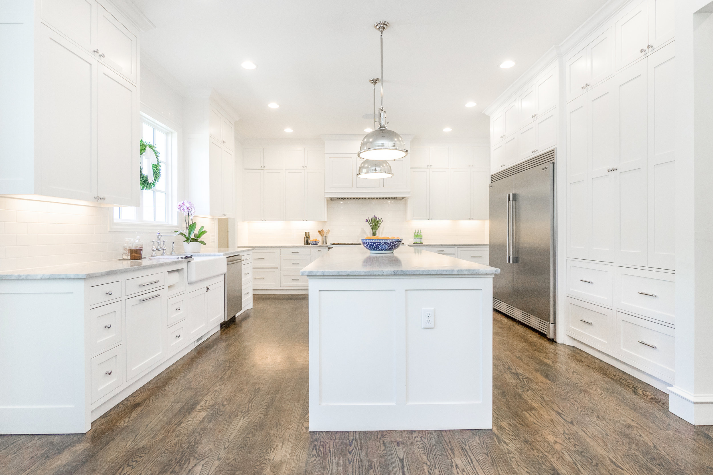 What a wonderful working kitchen! A place for everything! The tall cabinets on the right open for a work center. Small appliances and measuring items—all at your fingertips.