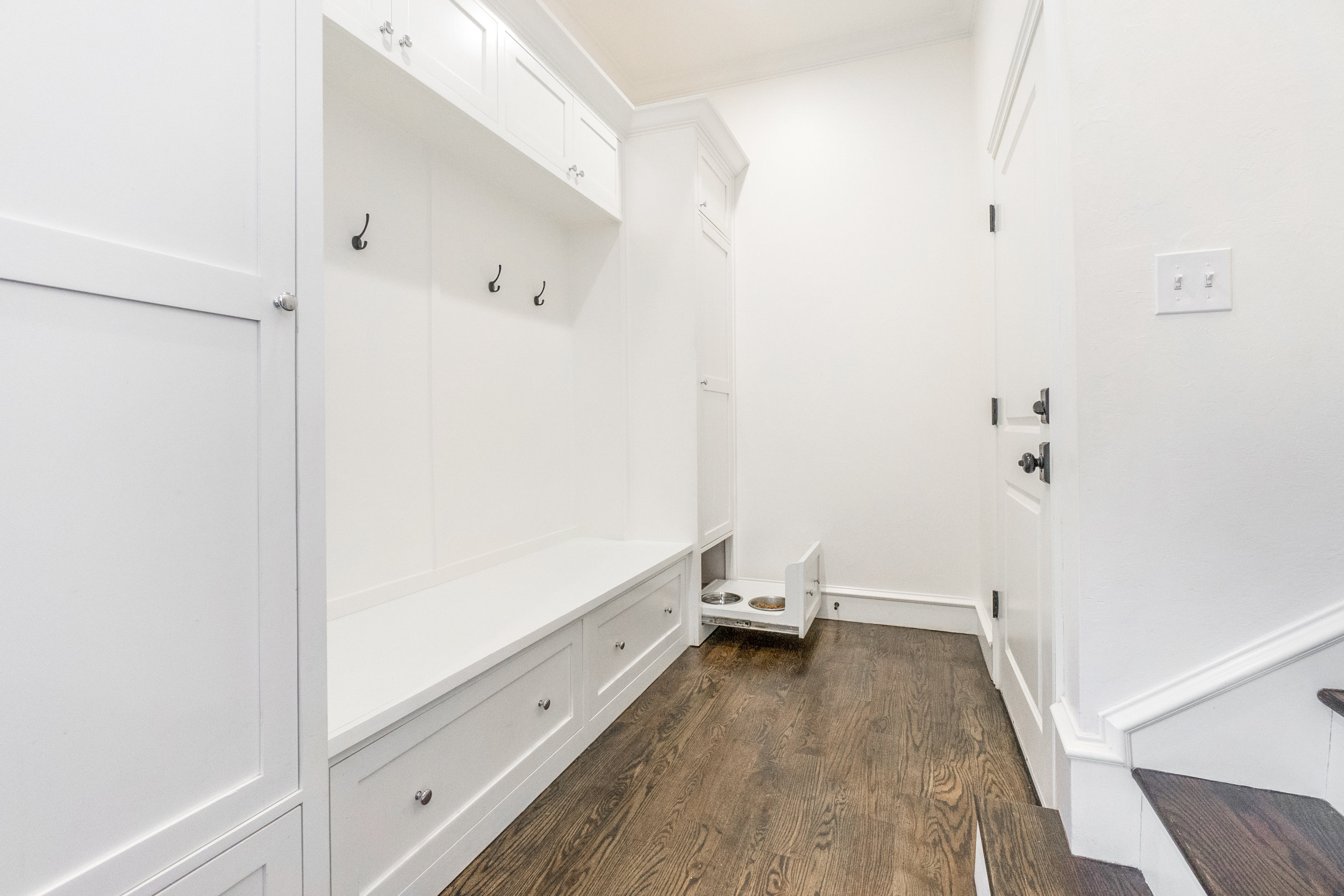 Mud room at opposite end of the coffee bar. The dog feeding station is clever . . . drawer closes and it's out of view easily.