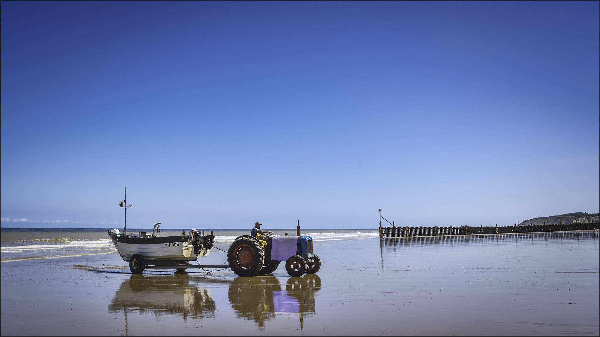 If you like crab meat then Cromer's the place, a crab boat coming in.
