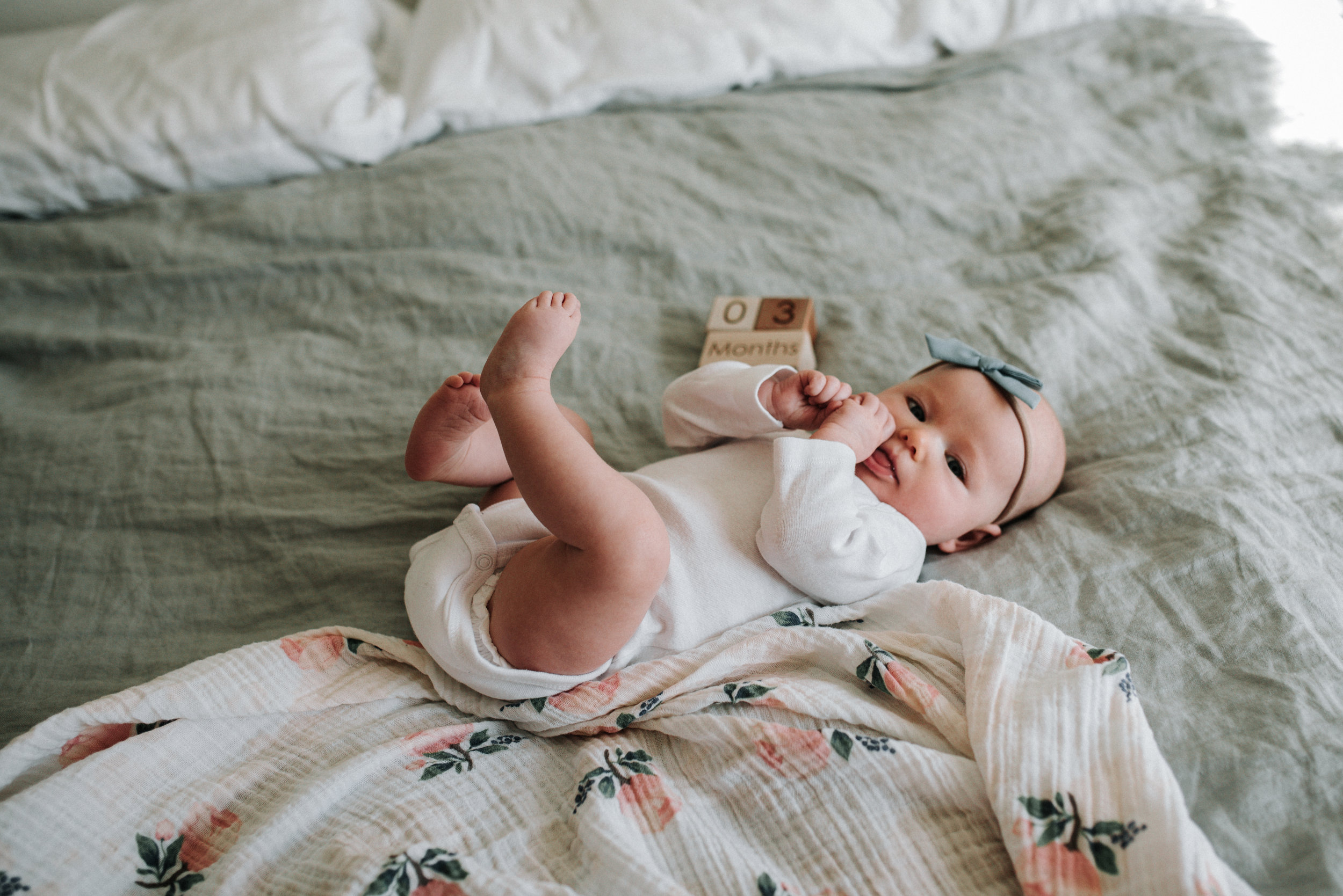As you can see in this image, the baby is dressed very simply but the understated bow and printed swaddle blanket add so much to the image.