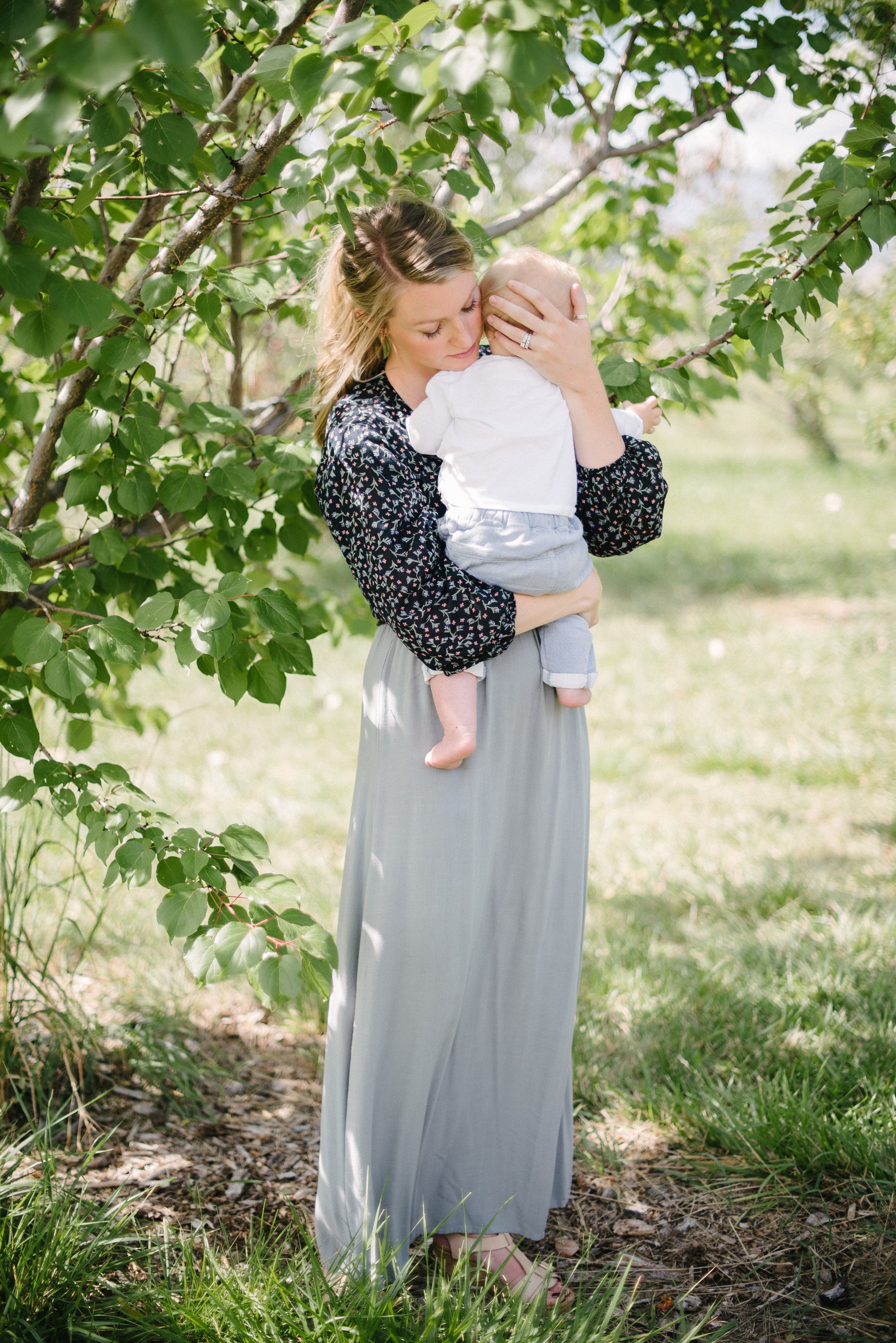 mother holding baby, motherhood photography Fort Collins