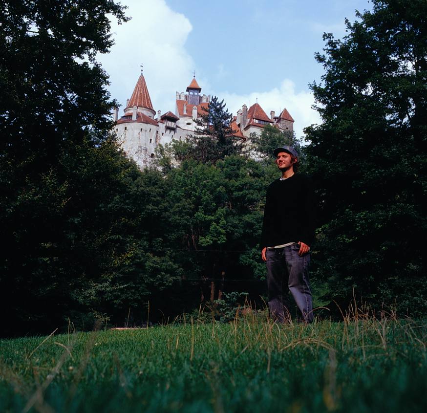 "Paul Shier in front of ""Dracula's Castle"" in the heart of Transylvania. Photo by Josh Stewart"
