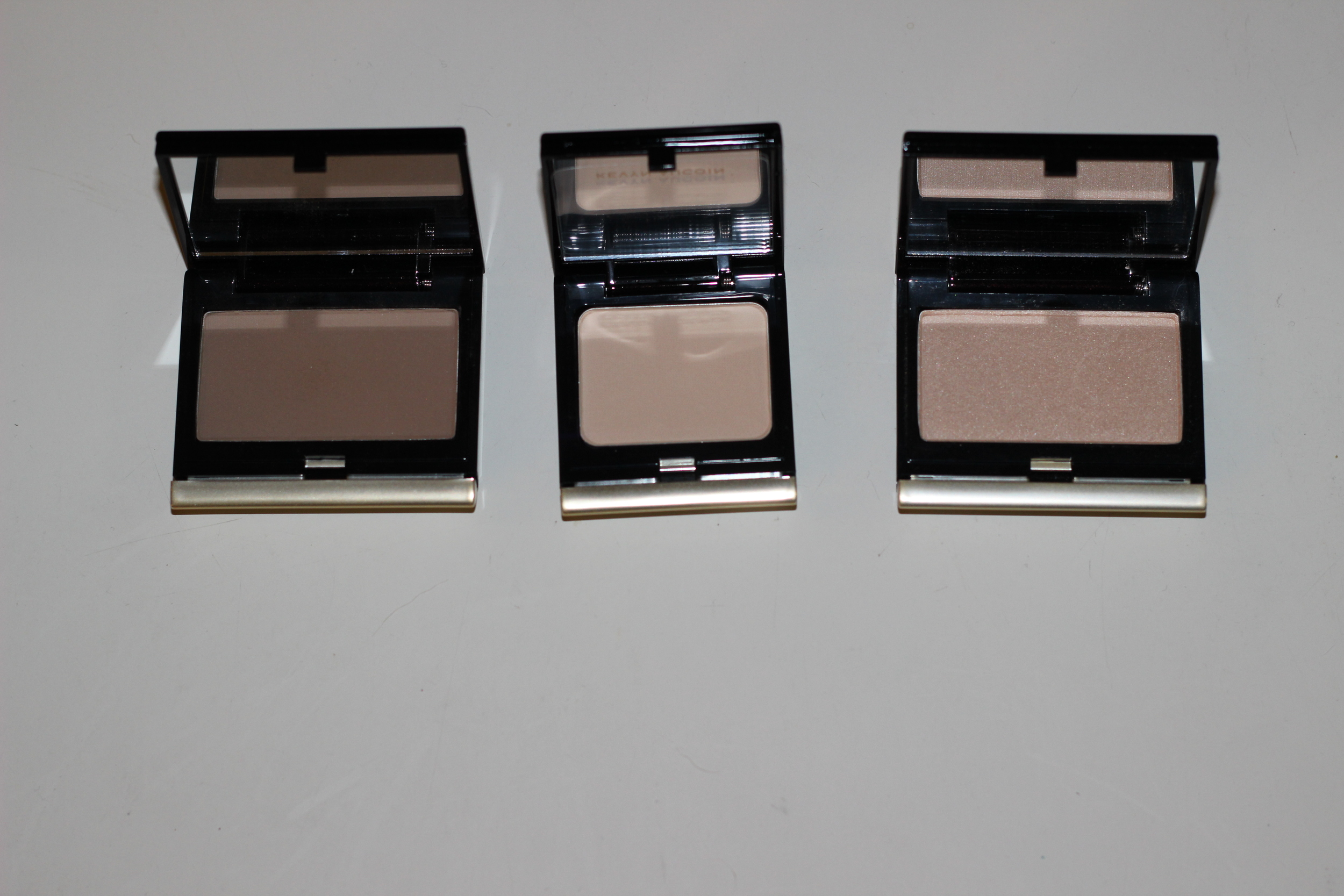 Left to Right: Sculpting Powder in Medium, Single Eyeshadow in Tusk, The Celestial Powder in Candlelight