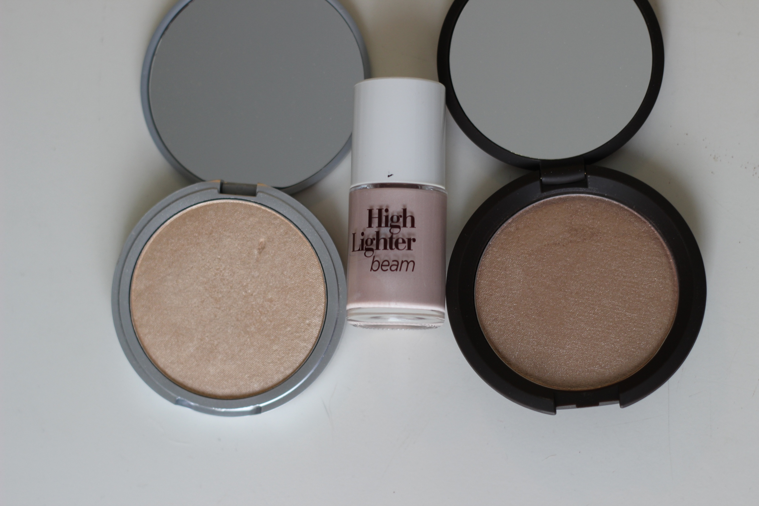 Left to Right: The Balm Mar Lou Manizer, The Face Shop High Lighter Beam, Becca Opal