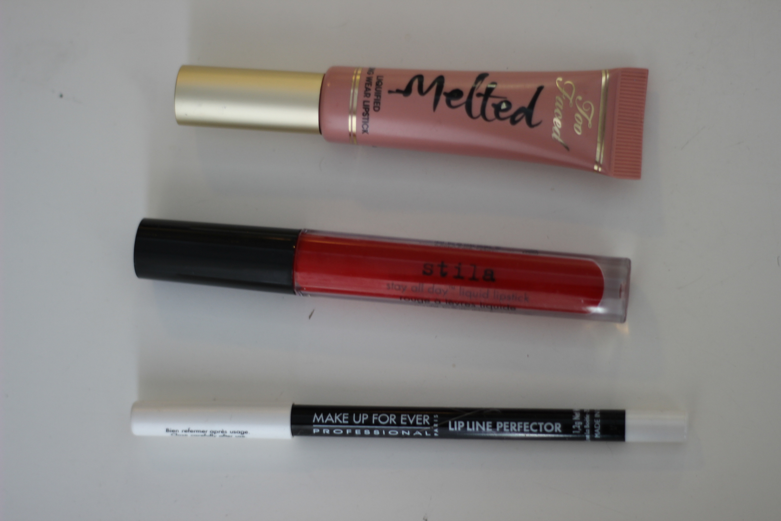 Top to Bottom: Too Faced Melted Nude, Stilla Stay All Day Beso, MUFE clear liner