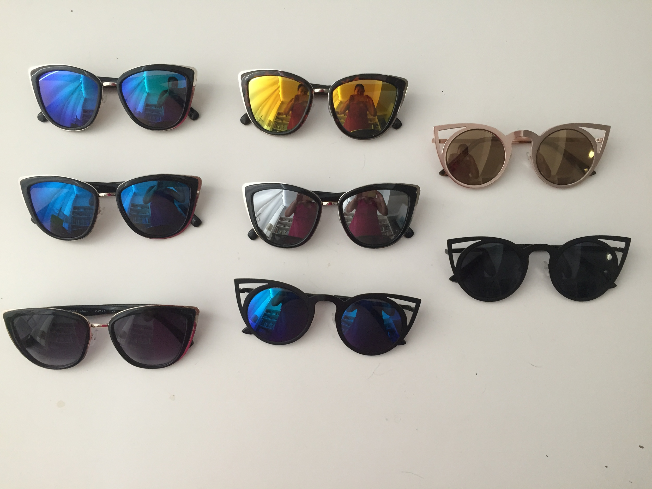 5 Pairs to the Left: Sunglass Spot  Style #4763 , $5 each  2 Pairs to the Right, Center Bottom Pair: Sunglass Spot  Style #3706 , $5 each
