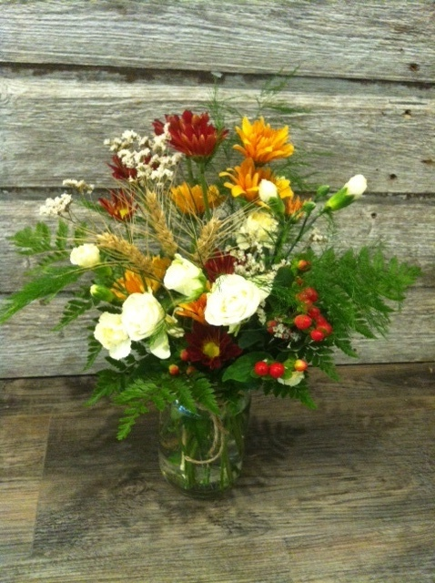 Beautifulfall arrangement in a mason jar