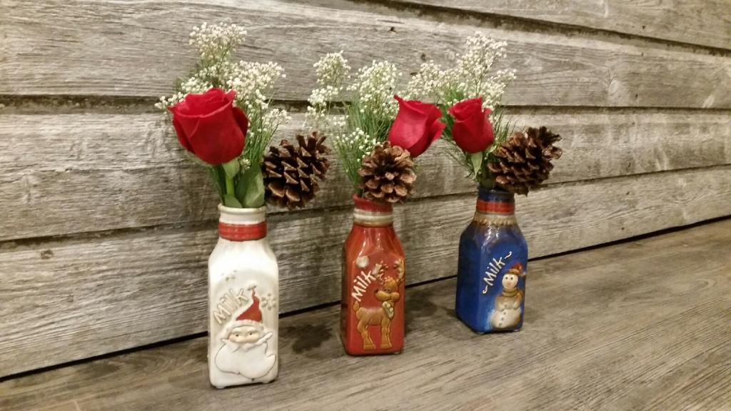 Three roses in Santamilk jugs!
