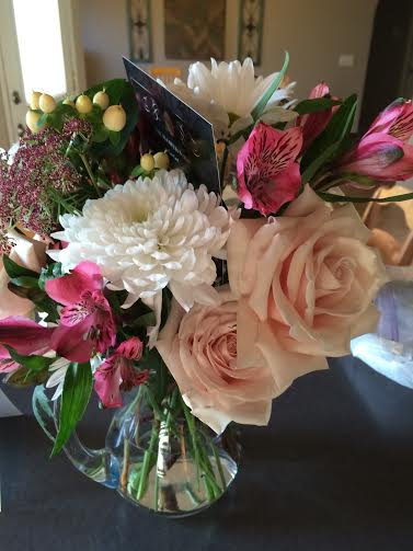 Blush roses in a pitcher