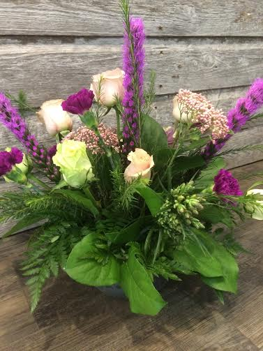 Sympathy arrangement with pinks, purples and greens