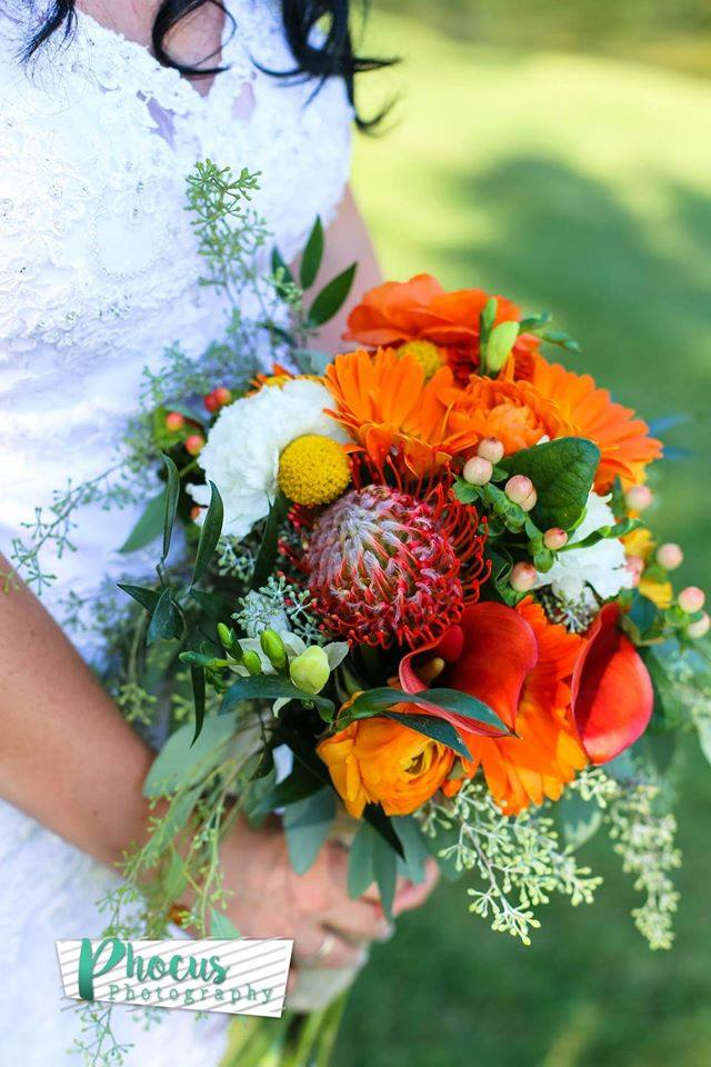 Shades of orange for this beautiful bride! (photo credit Phocus Photography)