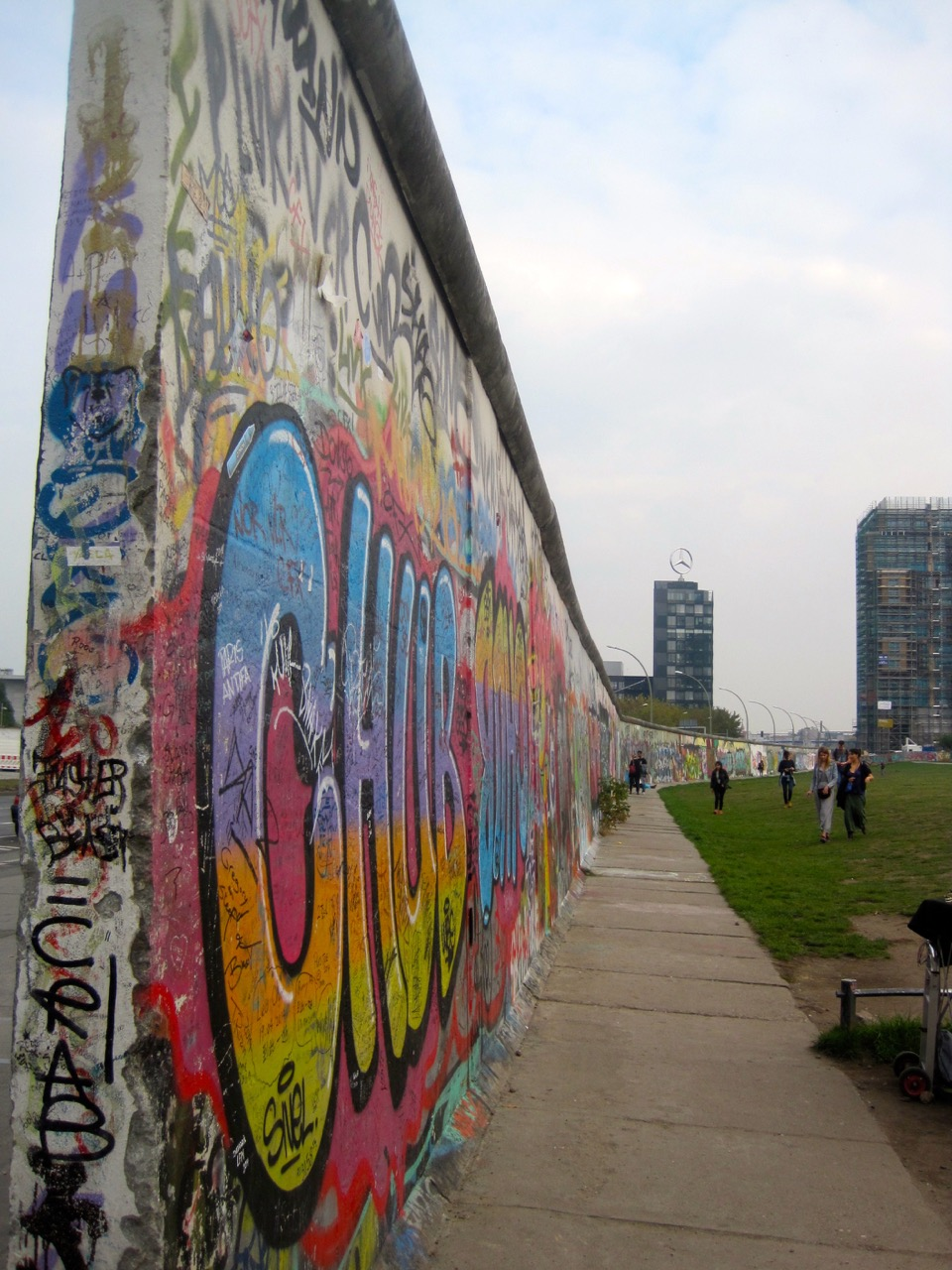 A large section of the Berlin Wall remains as the Eastside Gallery.