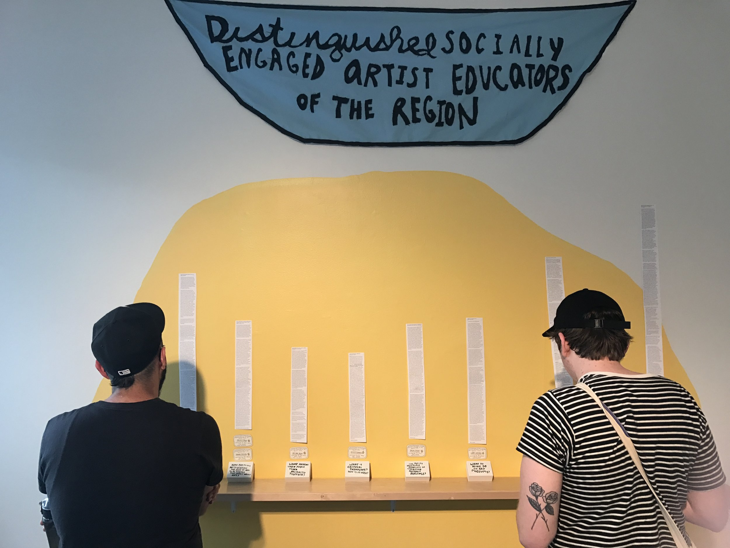 The eleven Distinguished Socially-Engaged Art(ist) Educators of the Region are people that fall into multiple categories related to art-education, and the region they hail from is my mind - they've all shaped how I think about socially-engaged art and public education. Their essays were installed as scrolls in the gallery along with their official card and hand-painted box (this set of items is their physical award).