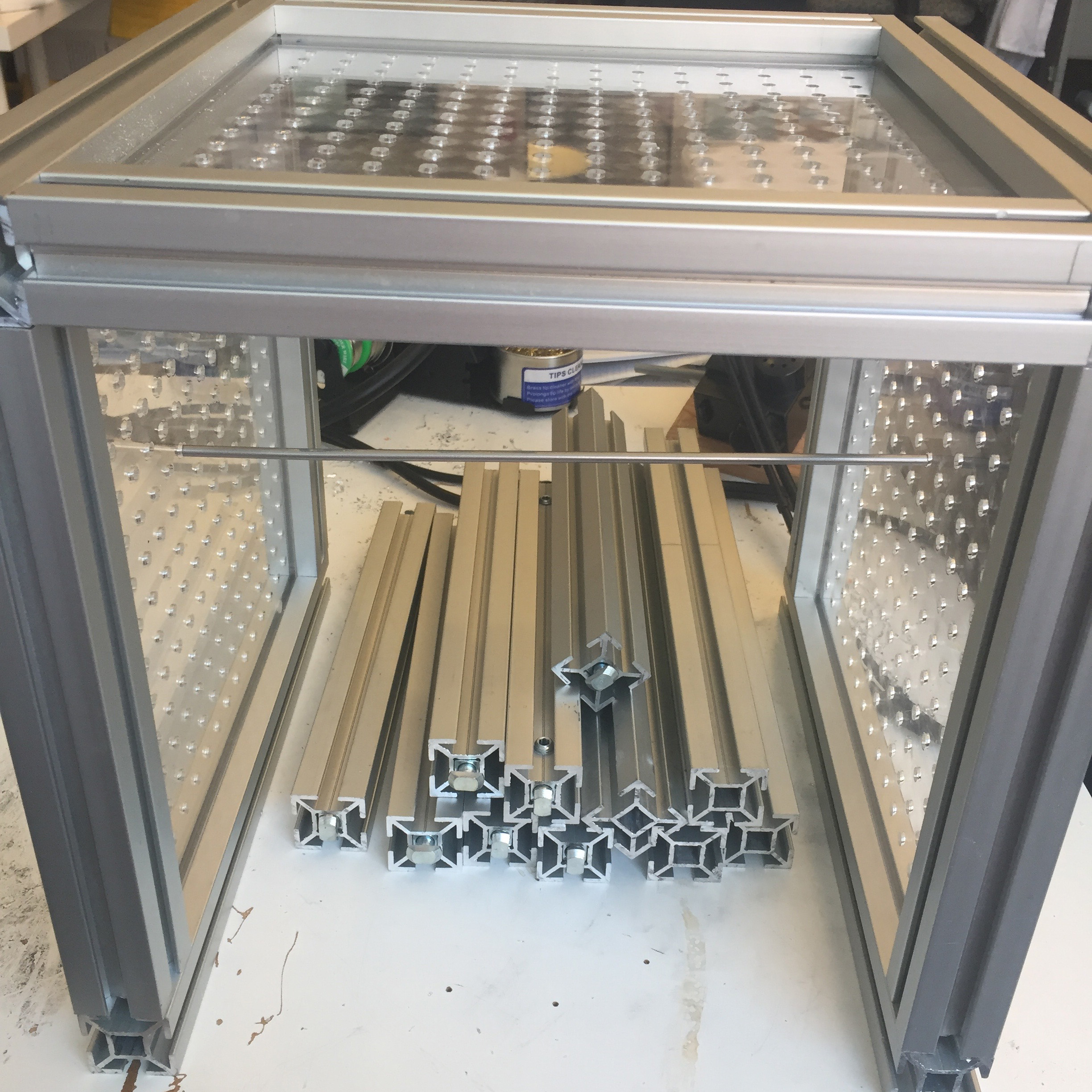 Prototype of a frame for a DIY automata machine. The plexiglass boards were lasercut at a local makerspace and the aluminum frame was designed and crafted by an exhibits developer.