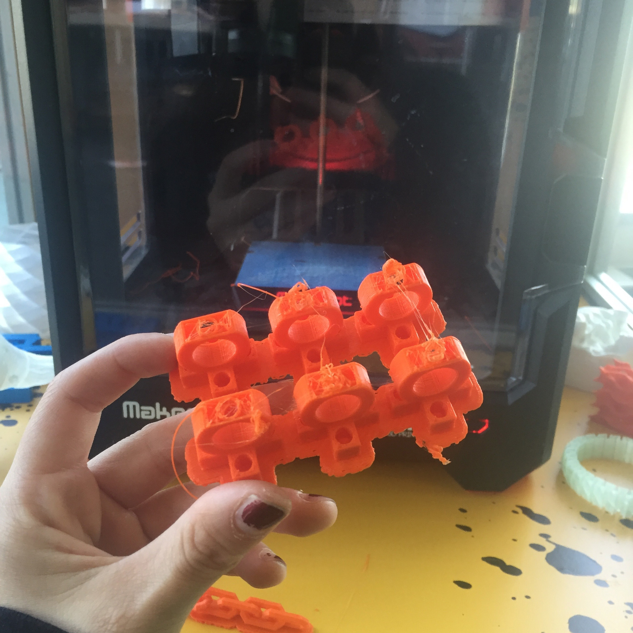 An example of using an exhibit component (3D printing station pictured previously) to create more exhibit components. These pieces were printed for use in an activity called Musical Linkages.