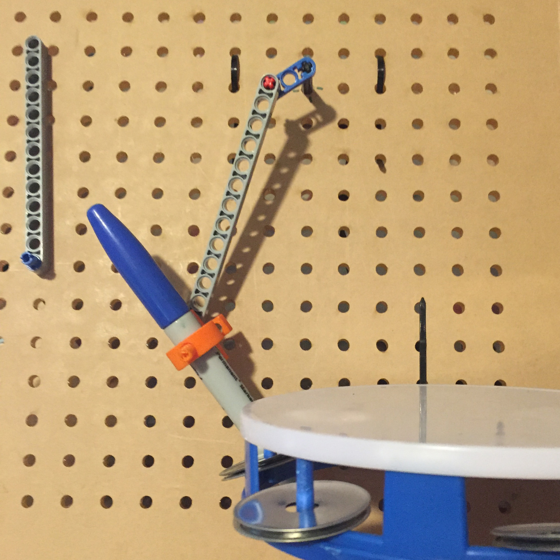 Lasercut prototype board for Musical Linkages, an activity developed by the Exploratorium in which you use motorized lego pieces that can be attached anywhere on a pegboard to create music making machines.