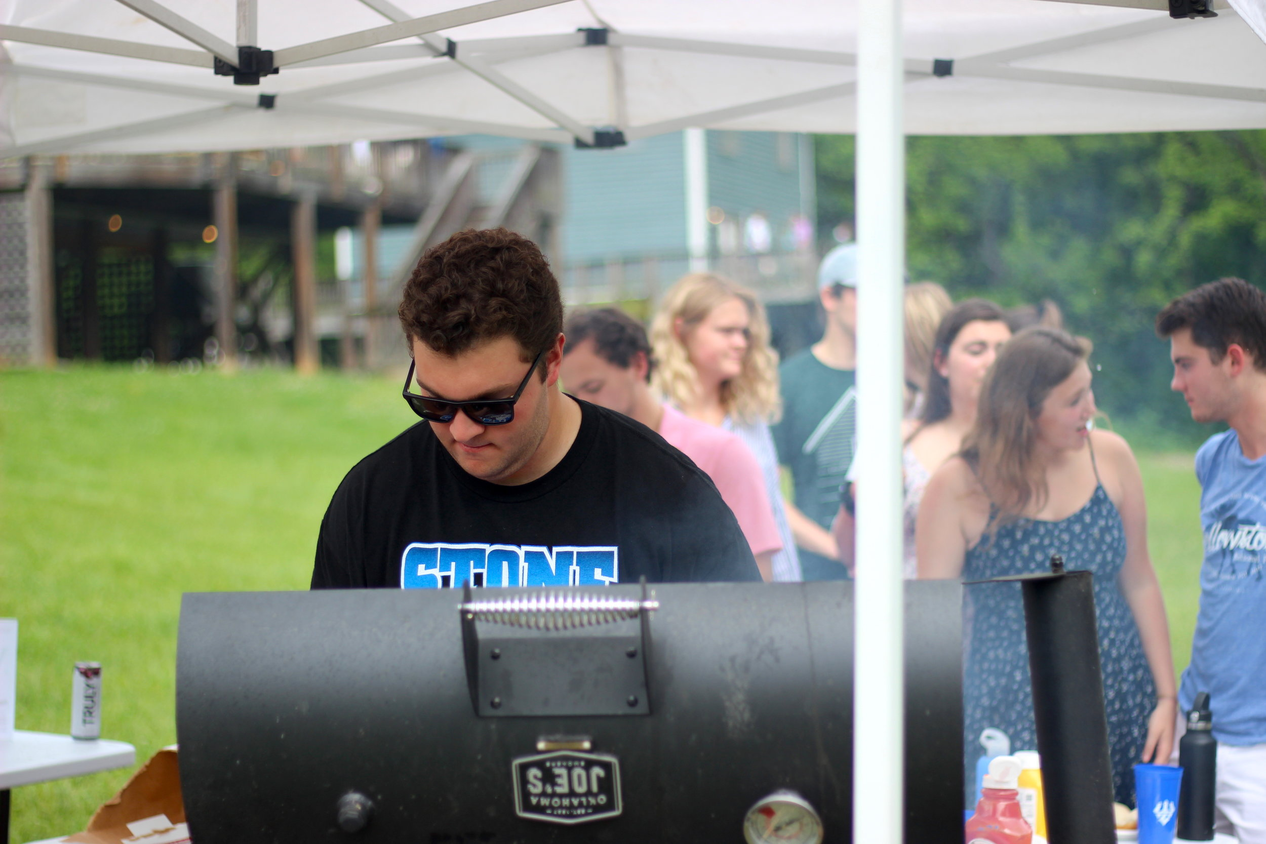 National Political Analyst and Grillmaster Kyle Perel '20 serves hamburgers and hotdogs to hungry students at Sunday's Derby Party.