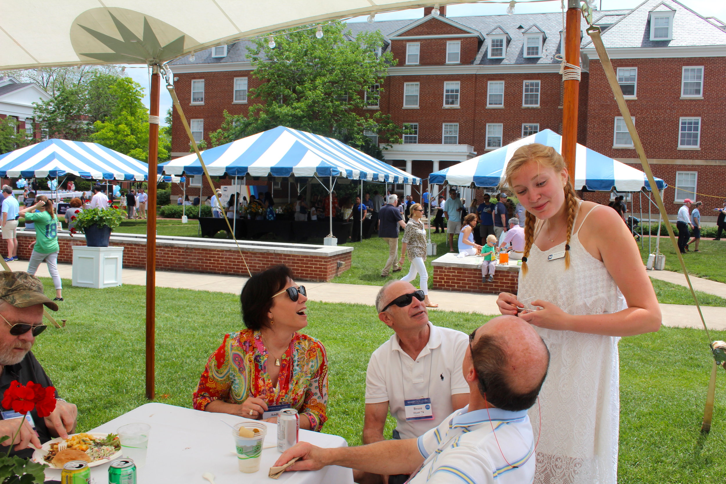 Financial Controller Kaitlyn Brock '20 chats with alumni during the picnic.