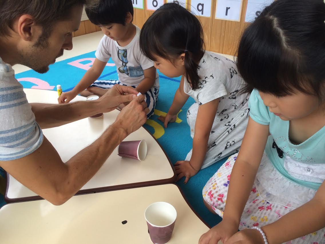 Things we prepared ------- brown paper, cups, doors, windows, glue  It's easy!!