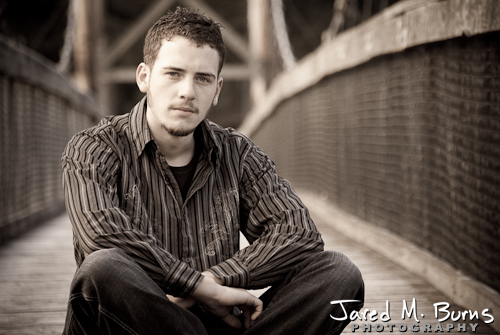 Duvall Cedarcrest Senior Guy Portrait Photographer - John McDonald Park, Carnation - Sitting on bridge