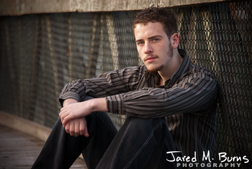 Duvall Cedarcrest Senior Guy Portrait Photographer - John McDonald Park, Carnation - Sitting against bridge