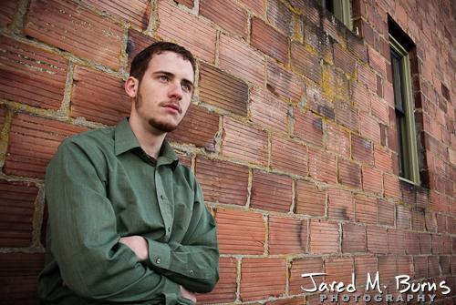 Duvall Cedarcrest Senior Guy Portrait Photographer - Carnation - Leaning on brick wall
