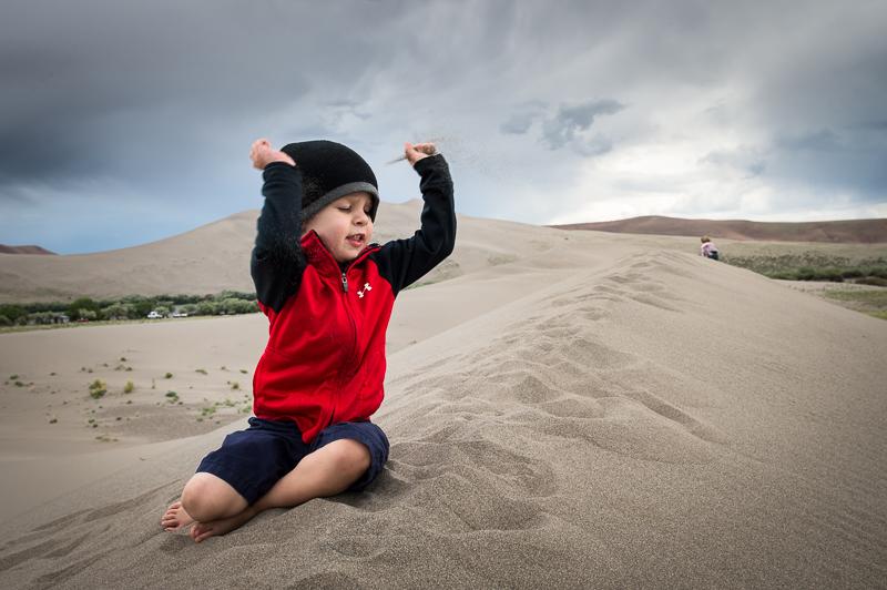 Keegan sits atop a sand dune - Bruneau Dunes State Park, ID