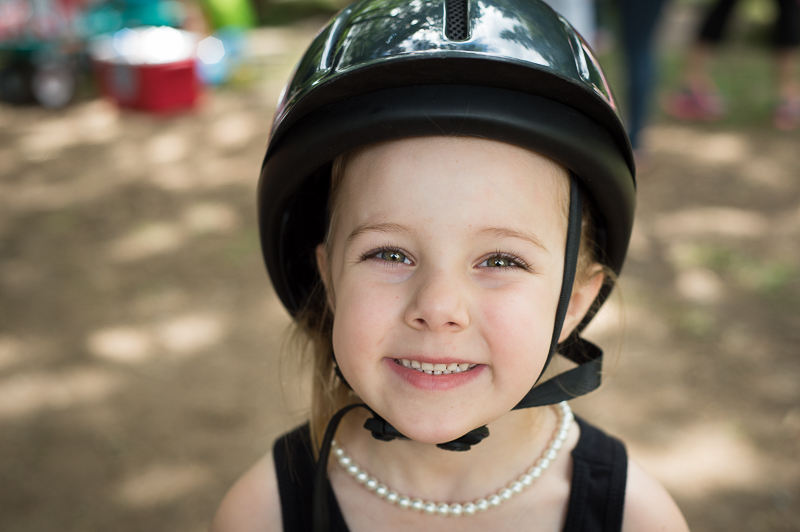Girl with a riding helmet.jpg