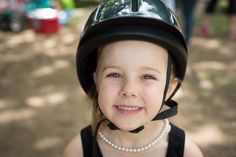 Girl with a riding helmet.jpg