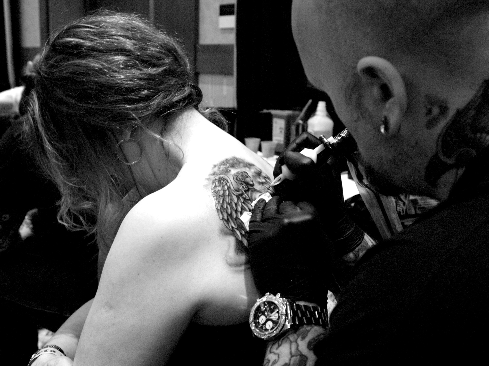 Bj Betts tattooing a guardian angel.