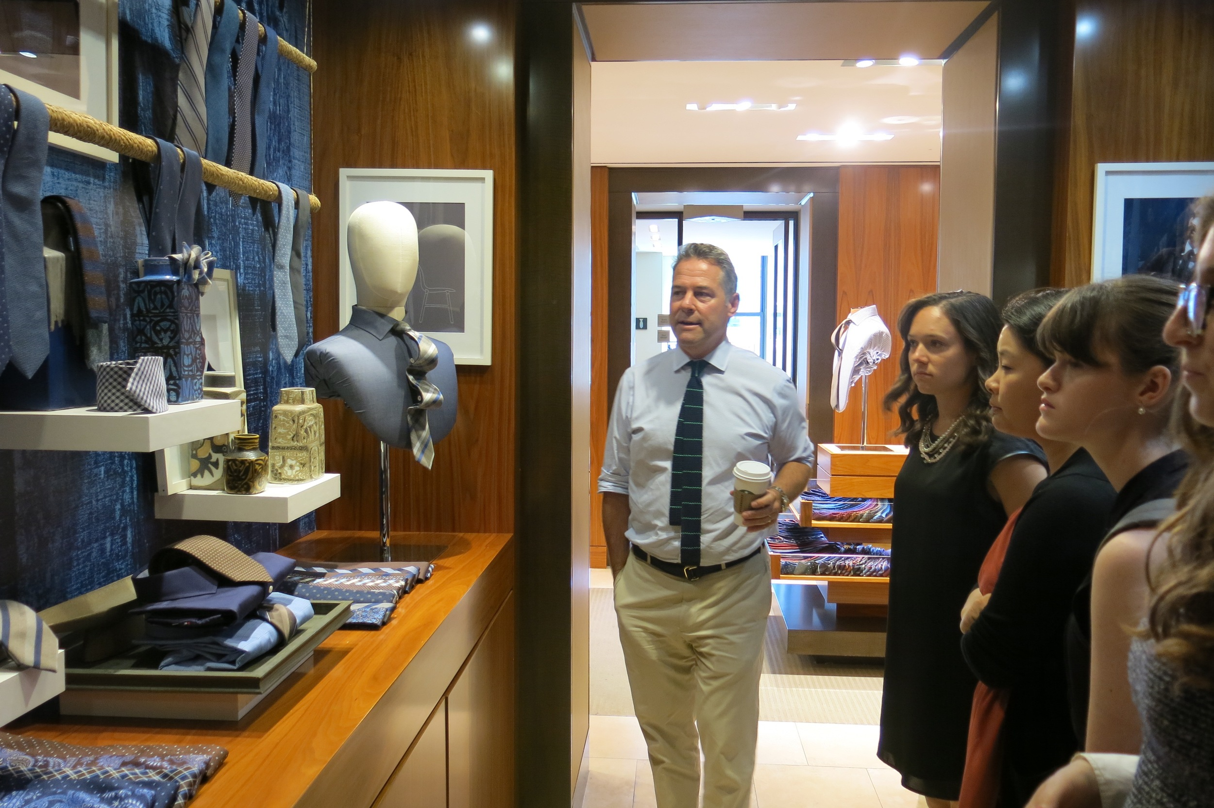 """Michael showing scholars the """"Indigo"""" collection, inspired by his trip to Copenhagen and Stockholm."""
