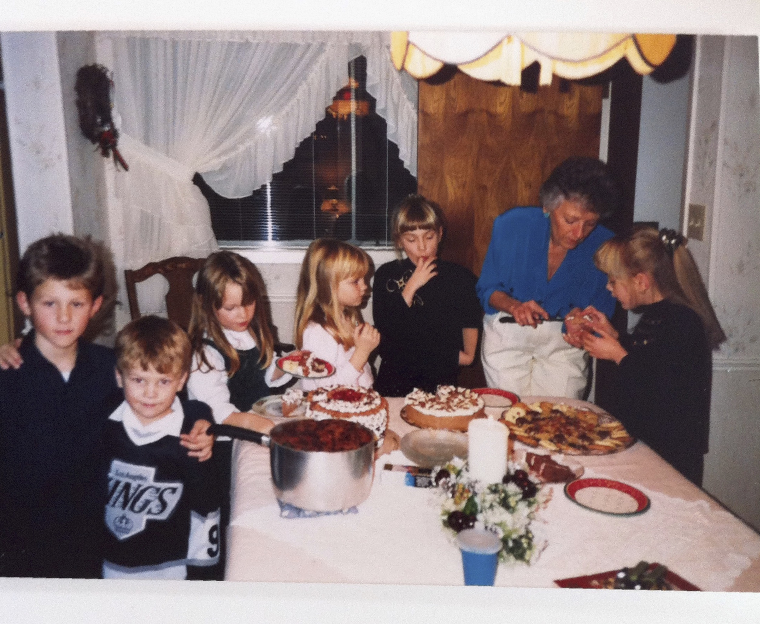 My Grandma, Joanne, serving up tasty desserts to me and my cousins, 'back in the day'. I'm the one who can't stop herself from tasting the food.