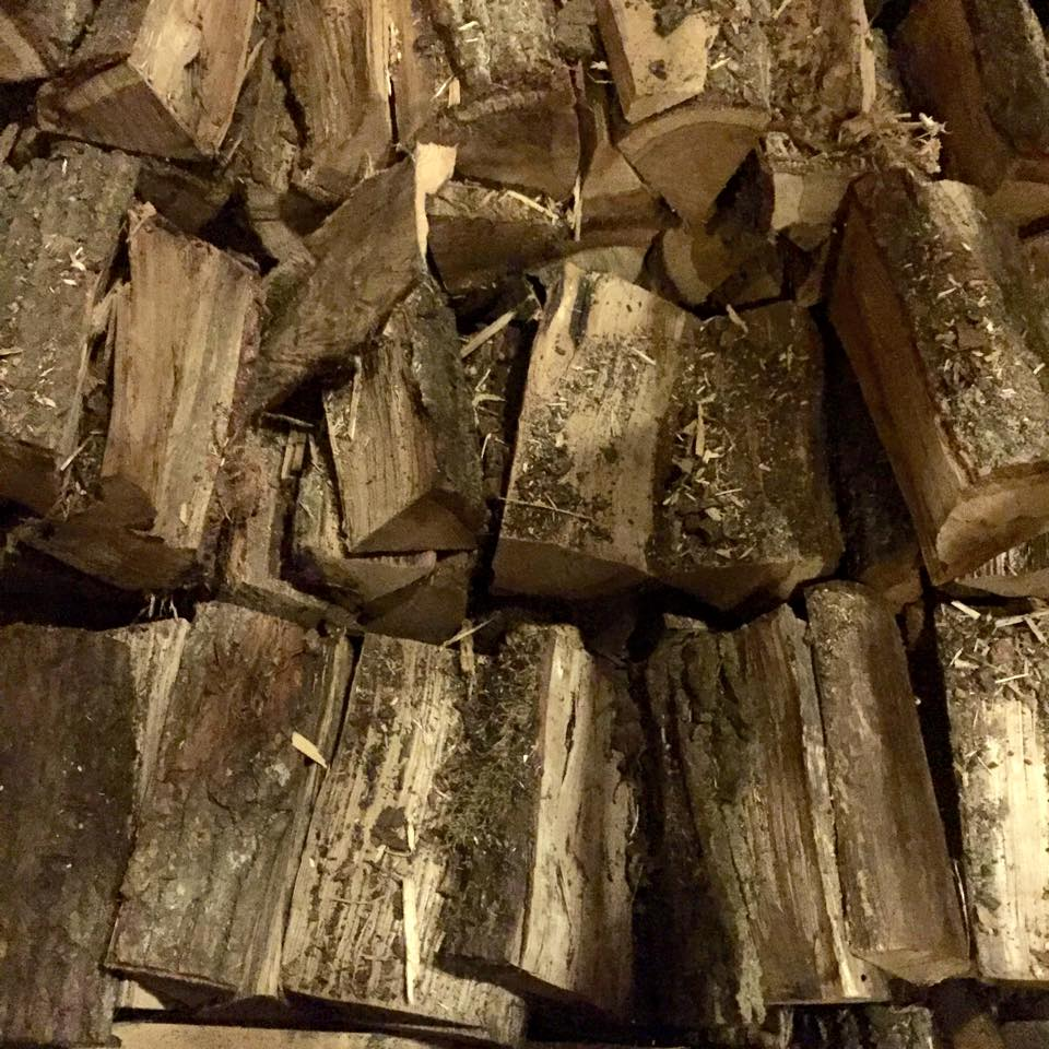 Piles of wood stacked in a Copenhagen bar. Something about firewood indoors makes me very happy. I don't have a fireplace, but I do have a wood smoke candle that makes me house feel and smell super cozy.