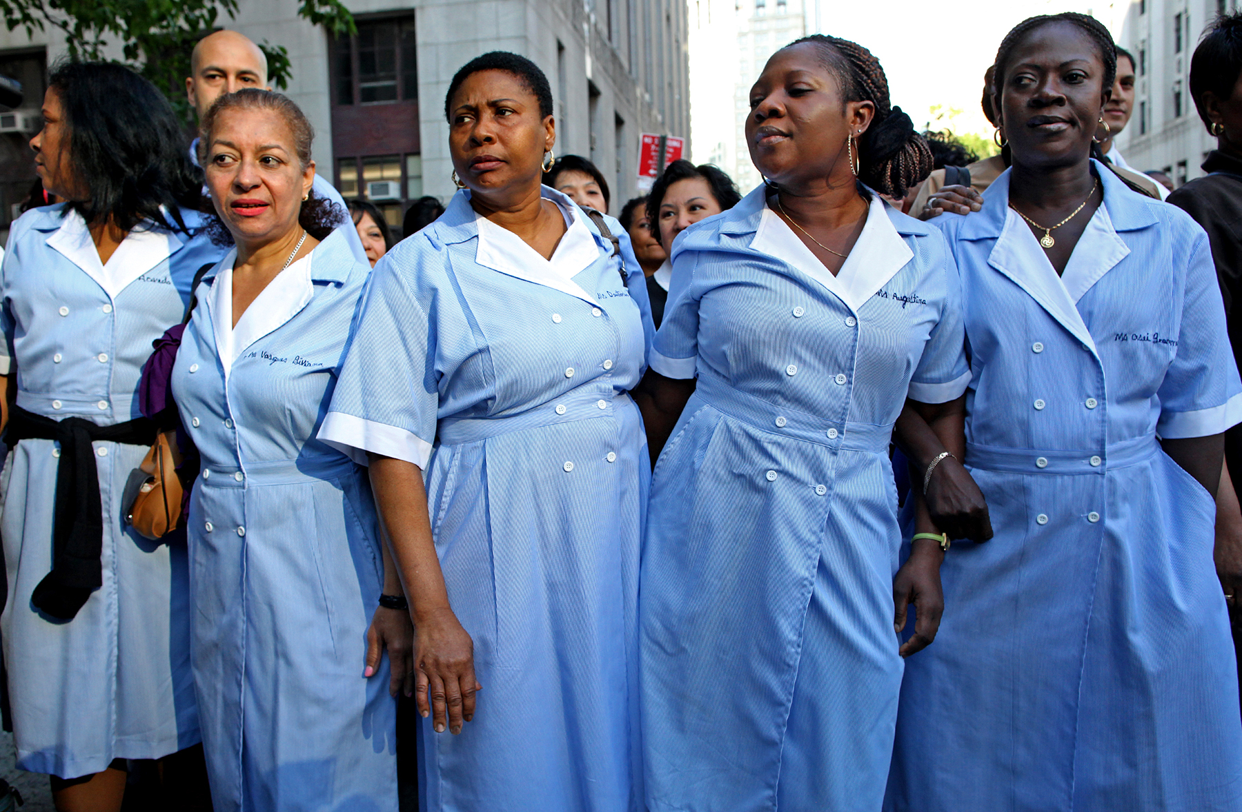 Housekeepers wait outside court for Dominique Strauss-Kahn, accused in sexual assault of colleague, 2011