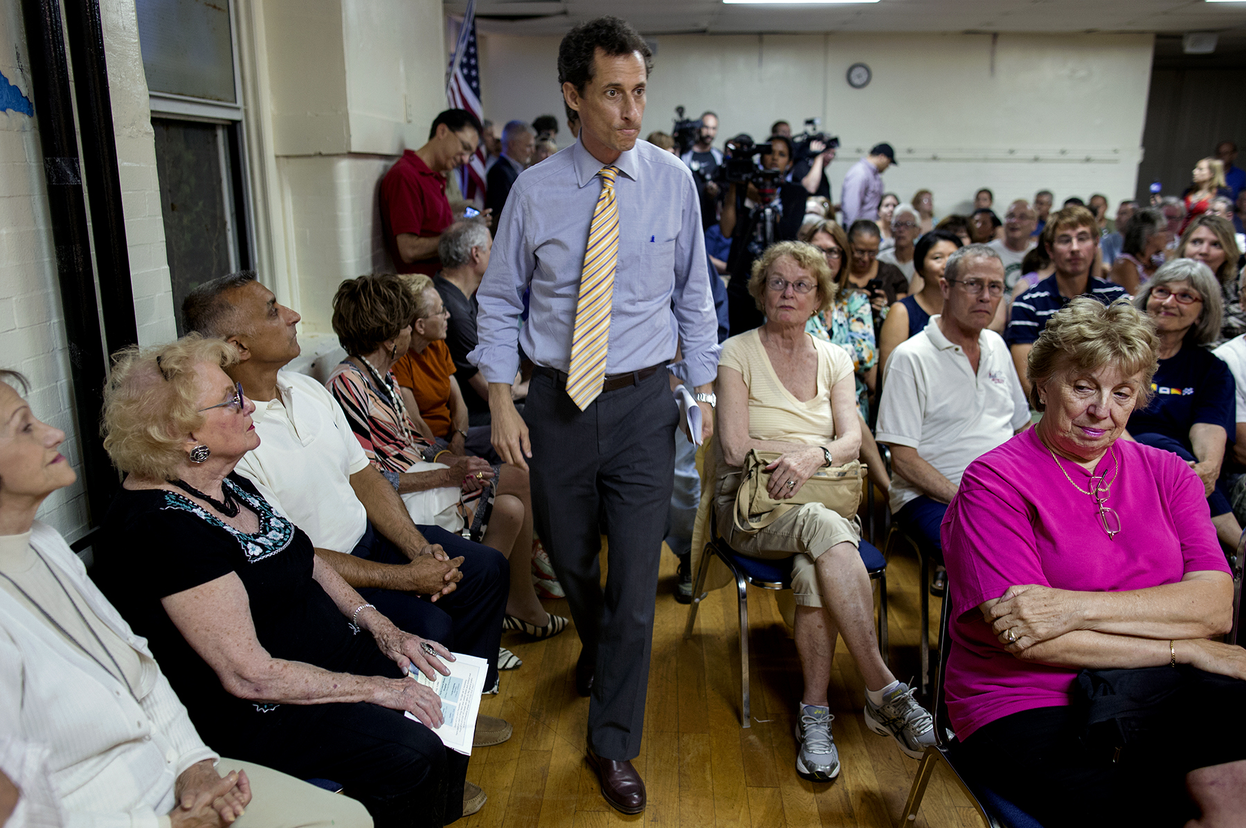 Embattled New York mayoral candidate Anthony Weiner arrives at a town hall meeting, 2013