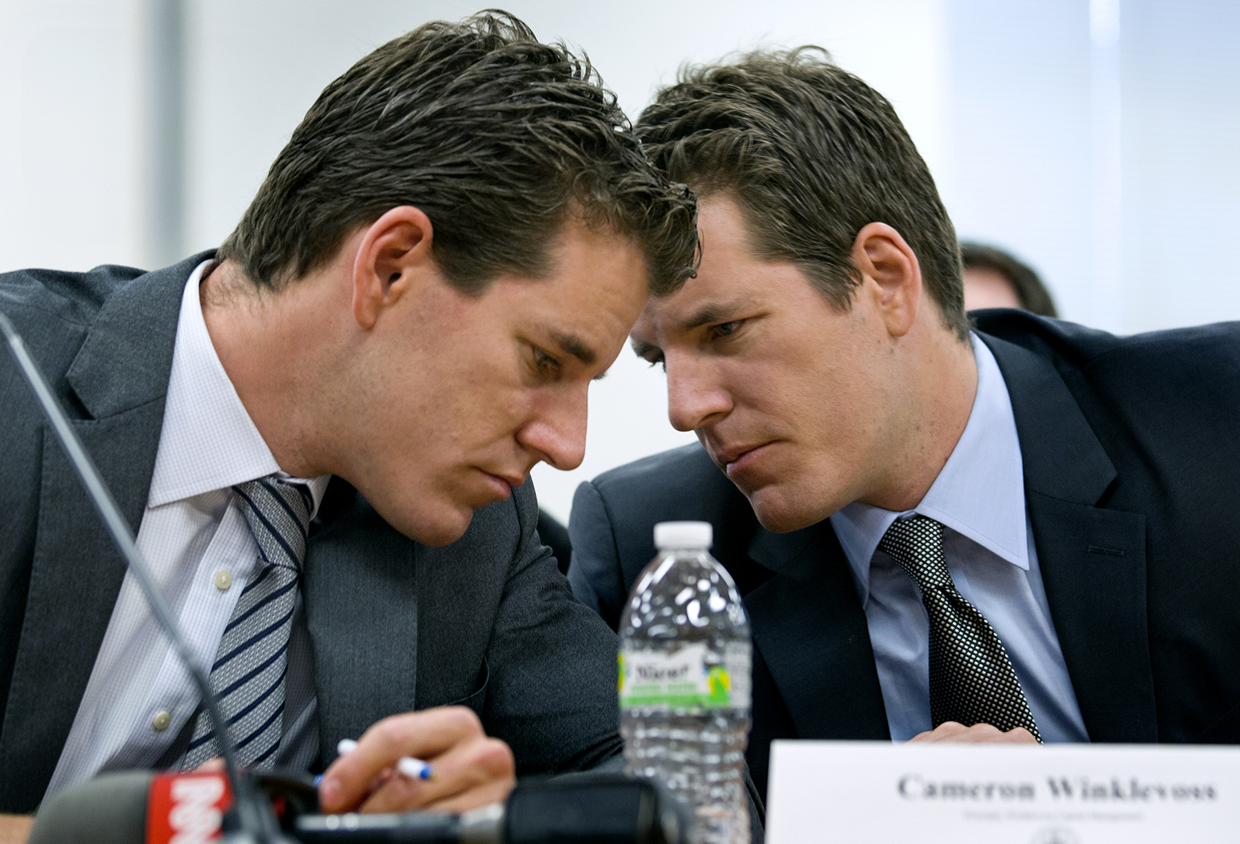 Entrepreneurs and twins Cameron, left, and Tyler Winklevoss testify at  modern currency hearing, 2014