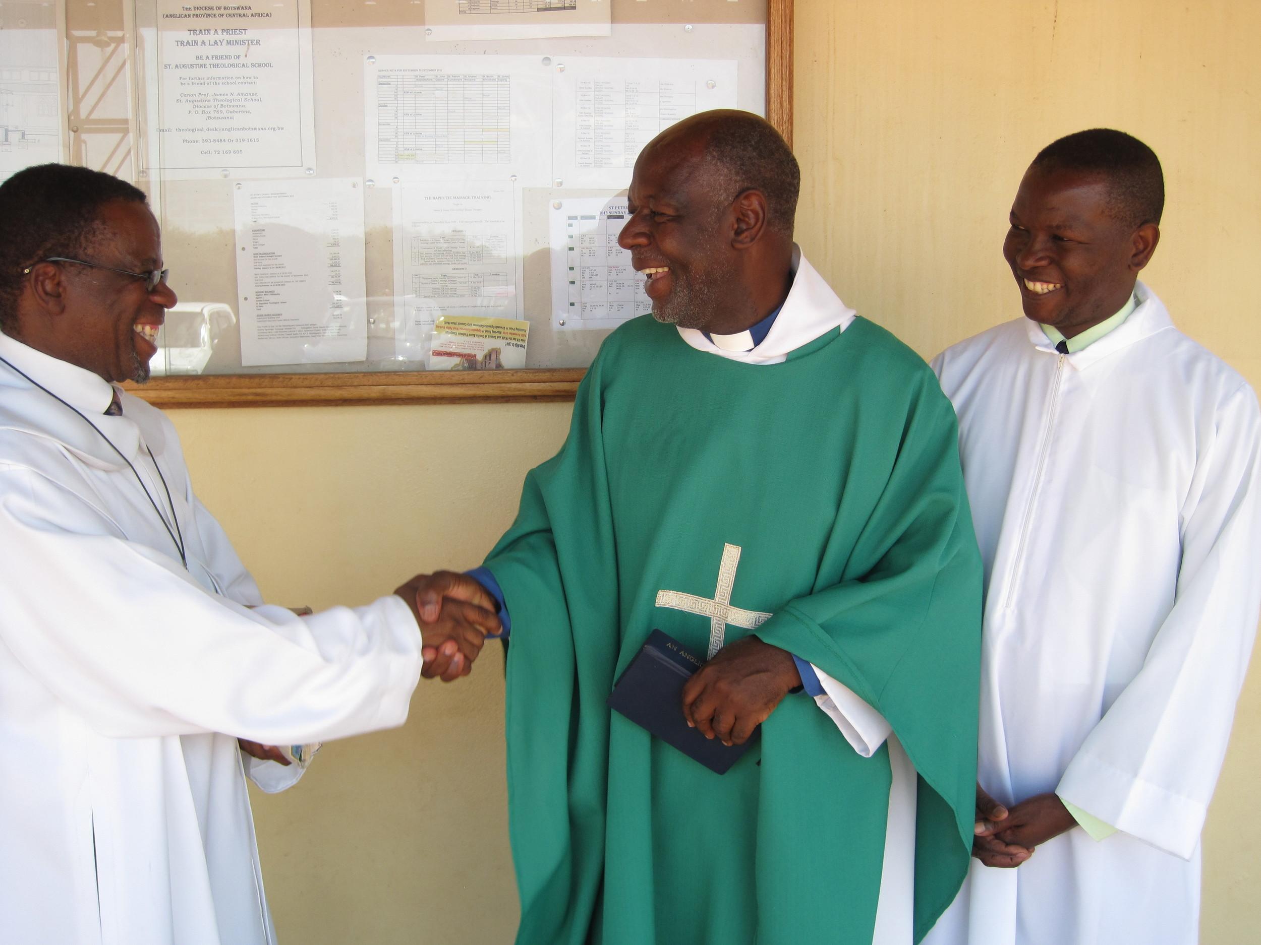 Ordinands Octavius Bolelang (left) and Bashie Tsheole   with Fr. Andrew Mudereri